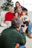 Man Photographing Family Through Smartphone Royalty Free Stock Image