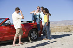 Man Photographing Friends Stock Photo