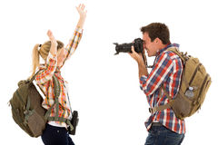 Man photographing girlfriend Royalty Free Stock Images