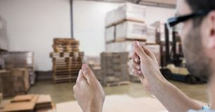 Man photographing goods through transparent device in warehouse Royalty Free Stock Photos