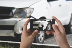 Man photographing his vehicle with damages. For accident insurance Royalty Free Stock Photos