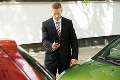 Man photographing his vehicle after traffic collision Royalty Free Stock Image