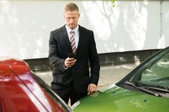 Man photographing his vehicle after traffic collision Stock Photos