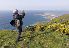 Man photographing a landscape Royalty Free Stock Photos