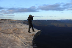Man photographing the landscape from Lincoln Rock Lookout at sun. Man photographer stands on a cliff and photographing the landscape from Lincoln Rock Lookout at Royalty Free Stock Photography