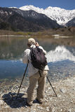Man Photographing Mountain Scenery Stock Image