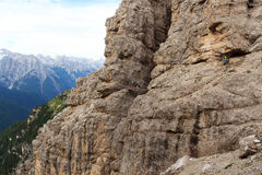 Man photographing people on the Via Ferrata Severino Casara with bridge in Sexten Dolomites mountains, South Tyrol Stock Photo