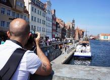 Man photographing river Stock Photos