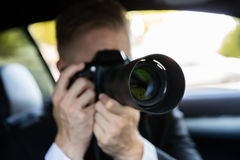 Man Photographing With SLR Camera Royalty Free Stock Images