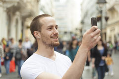 Man photographing with smart-phone Stock Photos