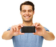 Man Photographing Through Smart Phone Stock Images