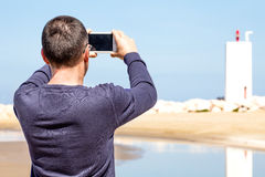Man Photographing With Smartphone Royalty Free Stock Image