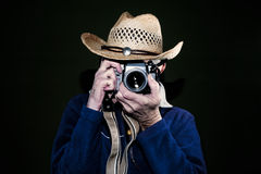 Man photographing with vintage film camera Stock Image