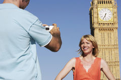 Man Photographing Woman Against Big Ben Tower Royalty Free Stock Photos