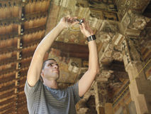 Man Photographing Wooden Detail In Temple Stock Photos