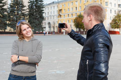 Man photographing young girl Royalty Free Stock Photo