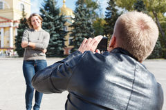 Man photographing young girl Royalty Free Stock Photography