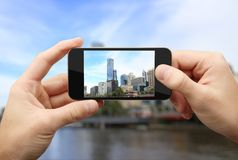 Man photographs city Royalty Free Stock Photos