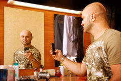 Man photographs herself in the mirror Stock Image
