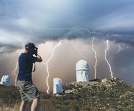A Man Photographs Observatories During a Storm Royalty Free Stock Photography