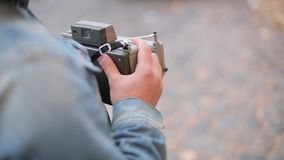 Man photographs with old school camera stock video