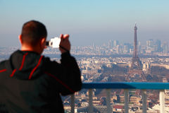 Man photographs of panorama of Paris Royalty Free Stock Photography