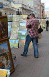 Man photographs on Stary Arbat Royalty Free Stock Photos