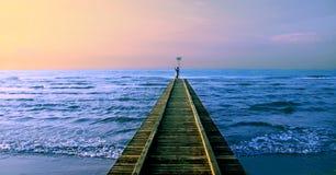 The man photographs sunrise on the sea Stock Photos
