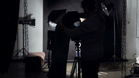 Man photographs of two girls on a retro camera. Man photographs of two cheerful girls on a retro camera stock footage
