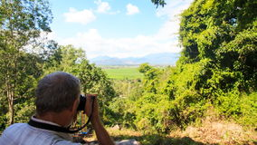Man Photos Valley from Top Tourist Observation Ground stock video footage