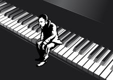 Man on the piano Stock Photo