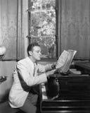 Man at piano with sheet music Royalty Free Stock Images