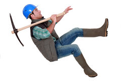 Man with pick-axe falling. Off chair Stock Photos