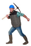 Man with pick-axe Royalty Free Stock Photography
