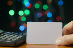 Man pick empty card have colorful bokeh as background Stock Photos