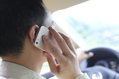 Man pick up phone when driving Stock Photos