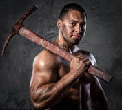 Man with pickaxe Royalty Free Stock Photos