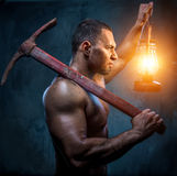 Man with pickaxe Royalty Free Stock Image
