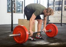 Man Picking Barbell in Gym Stock Photography