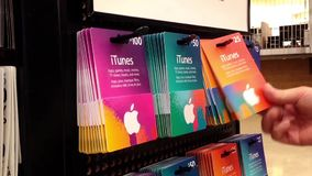 Man picking the itunes gift card stock video