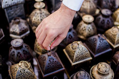 Man picking a Lantern. A man picking a lantern in Dubai Souq Stock Images