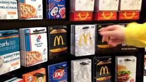 Man picking the mcdonald gift card stock footage