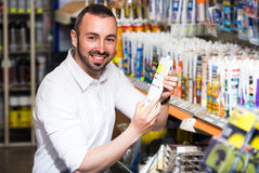 Man picking sealing component Royalty Free Stock Image