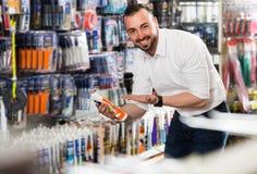 Man picking sealing component Stock Image