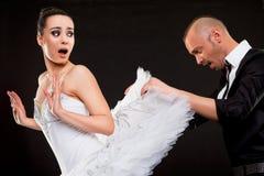 Man picking under ballerina skirt Stock Images