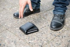 Man Picking Up Fallen Wallet Royalty Free Stock Photo