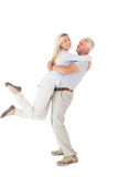 Man picking up his partner while hugging here Royalty Free Stock Photo