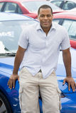 Man picking up new car. From lot Stock Images