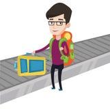 Man picking up suitcase on luggage conveyor belt. Stock Photography