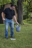 Man Picking Up Trash With Pick Up Tool Royalty Free Stock Images